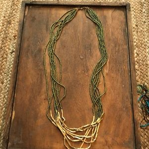 Green and gold long necklace